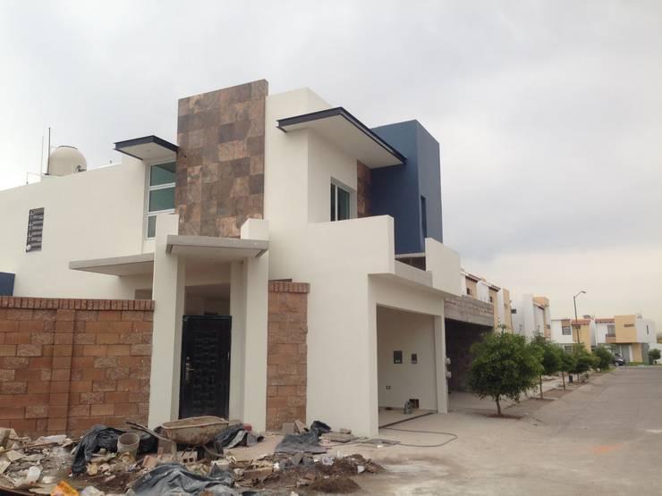 ACABADOS FINALES: Casas de estilo  por Arquitectura-Construcciòn Godwin
