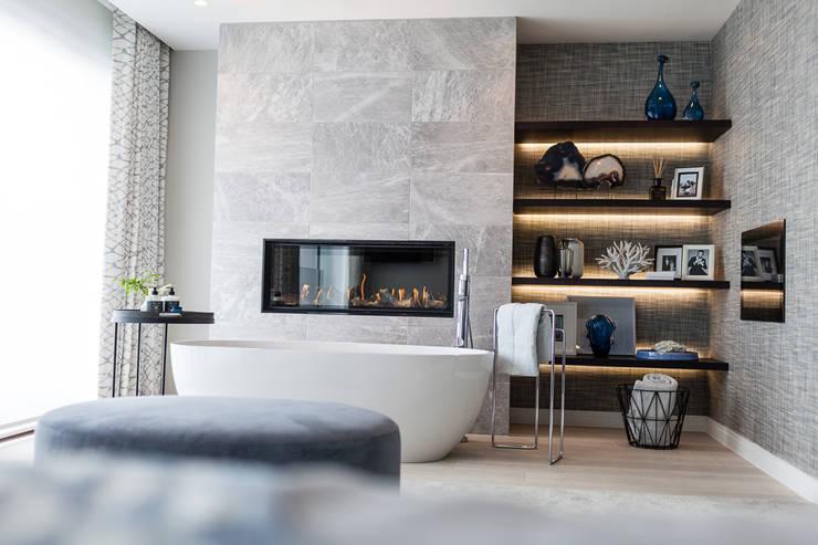 Elegante: Baños de estilo  por Claudia Luján