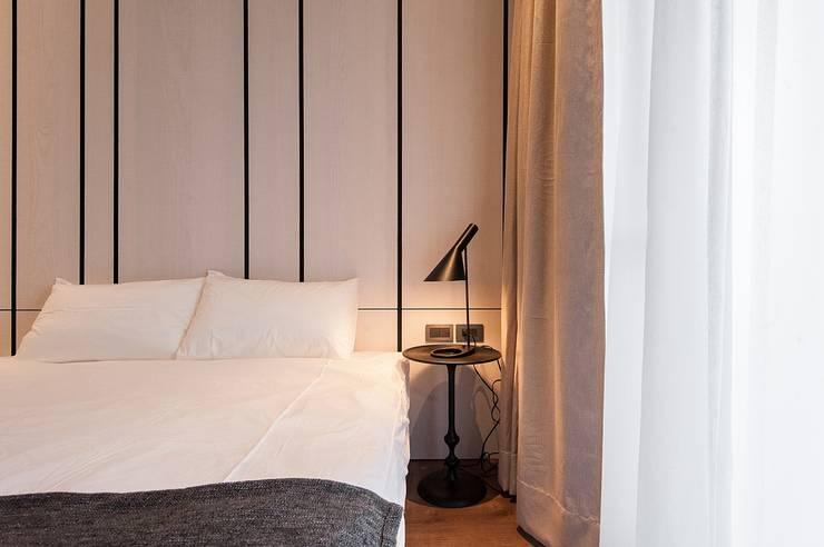 溫潤:  臥室 by 沐駿室內設計有限公司