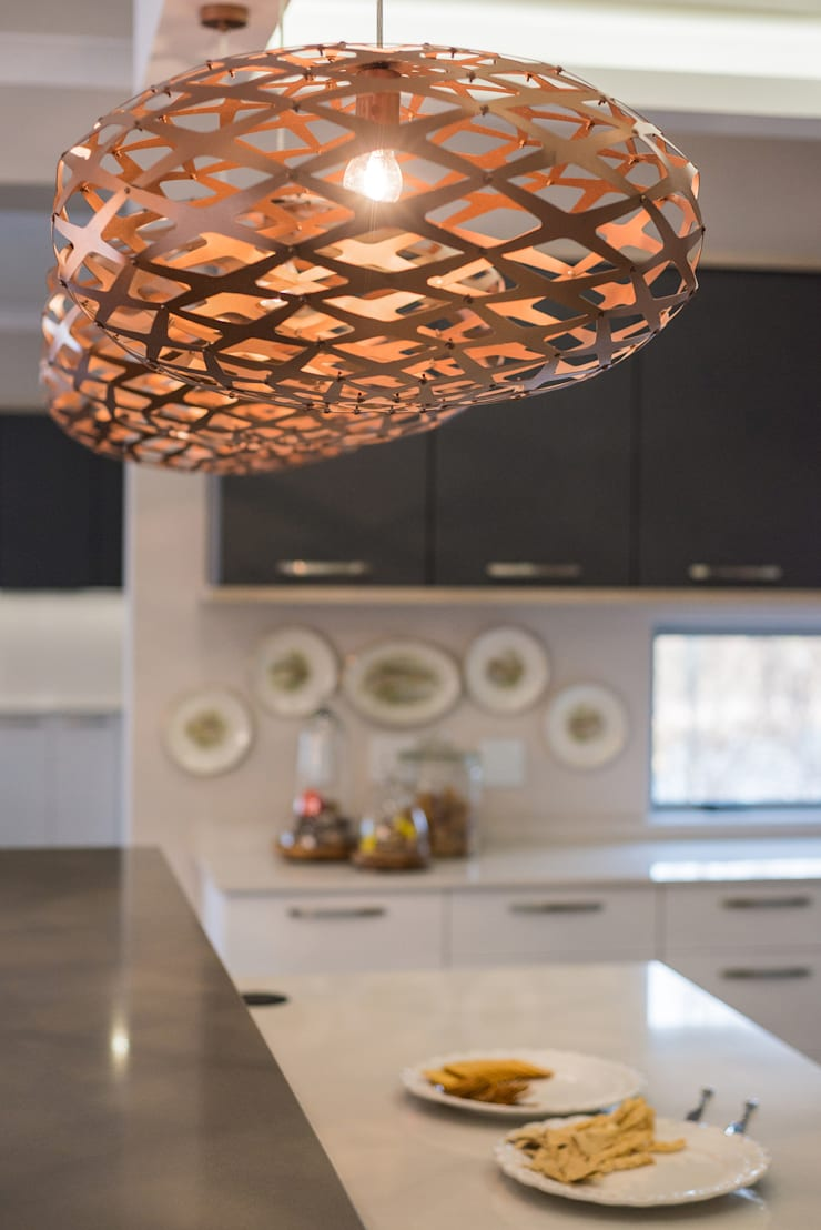 Decor details in the lights.  :  Kitchen by Carne Interiors