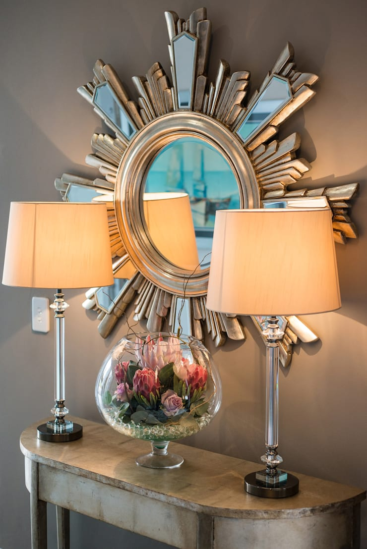 Decor details: mirror, lamps.  :  Corridor & hallway by Carne Interiors