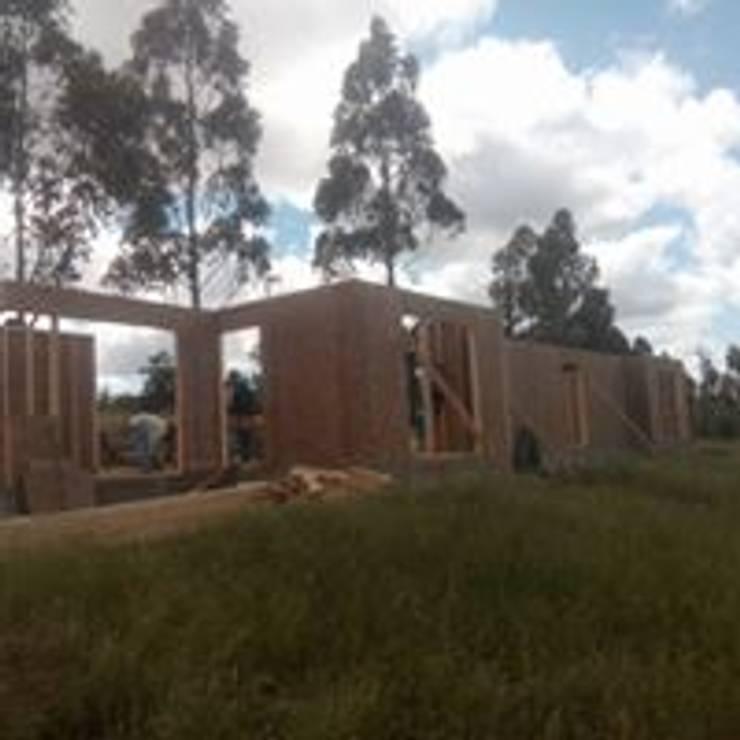 casas campo playa:  de estilo  por construcciones costa