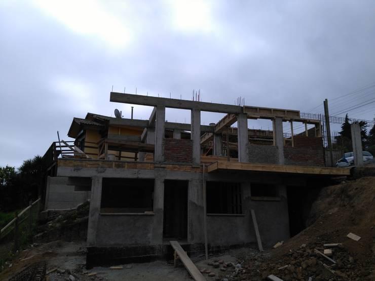Proyecto de cabañas:  de estilo  por construcciones costa