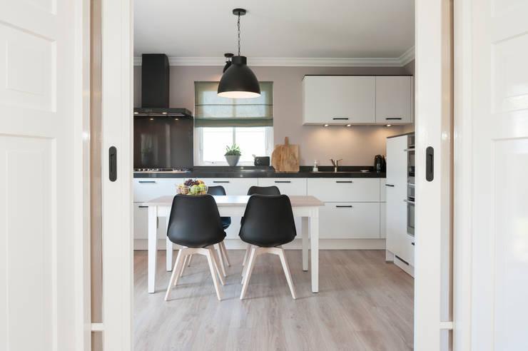Woonhuis:  Keuken door CM Interieurarchitect