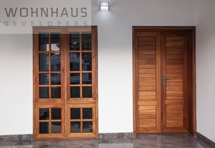 1400sqft House in Trivandrum:  Single family home by Wohnhaus Developers