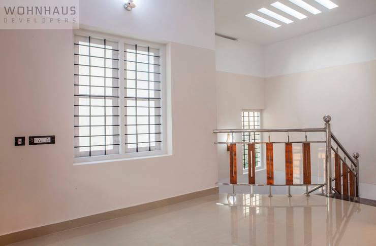 1400sqft House in Trivandrum:  Corridor & hallway by Wohnhaus Developers
