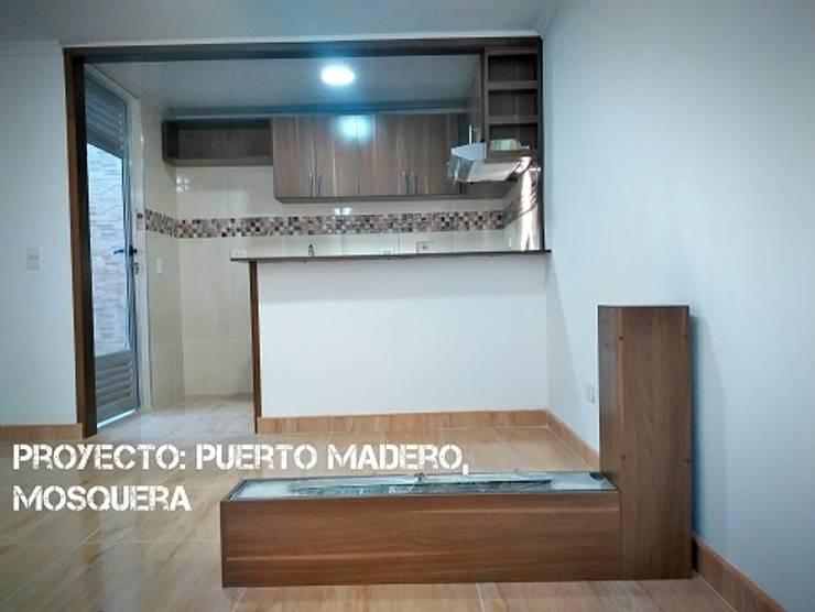 Casa Puerto Madero : Casas unifamiliares de estilo  por Construcolmena SAS