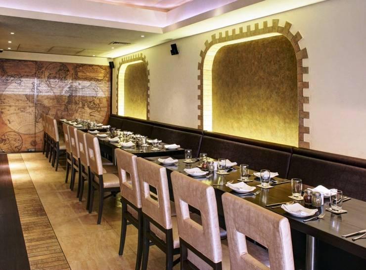QUESSO RISTORANTE:  Walls & flooring by STELLE DESIGN PVT LTD