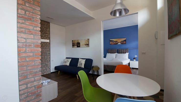 Salas / recibidores de estilo  por studiodonizelli