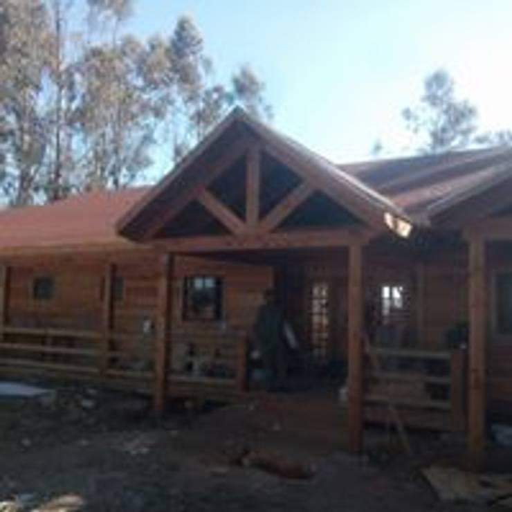 casa campo: Casas de estilo  por construcciones costa