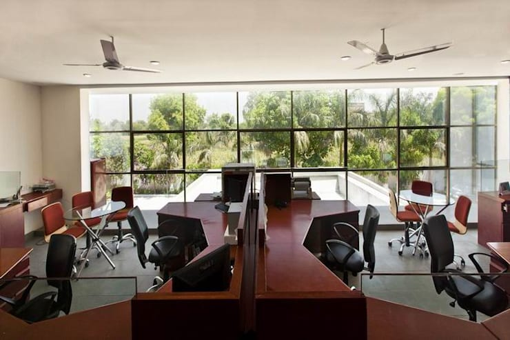 First Floor Office:  Office buildings by Studio - Architect Rajesh Patel Consultants P. Ltd ,Modern
