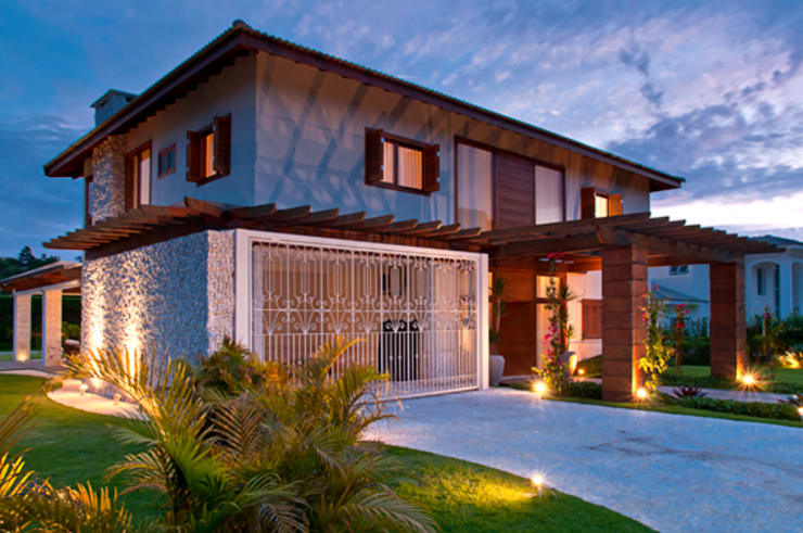 Casas unifamiliares de estilo  por MACHADO DE ALMEIDA ARQUITETURA E INTERIORES