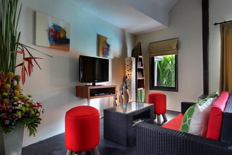 TV Room:  Living room by Credenza Interior Design