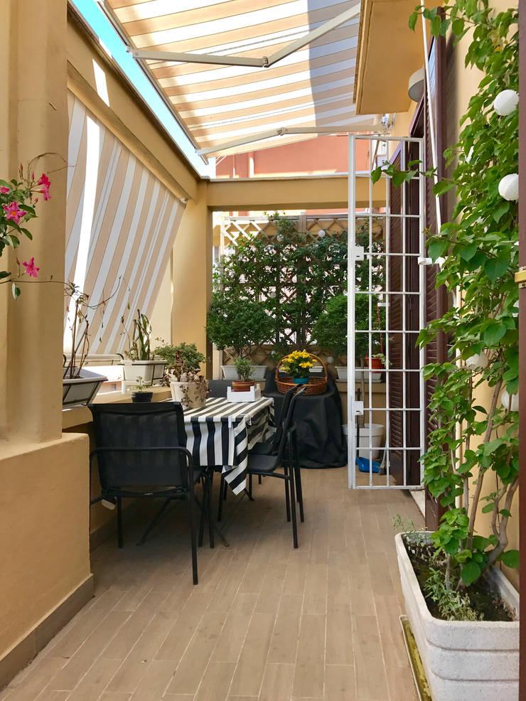 Terrazas de estilo  por EMC2Architetti, Moderno