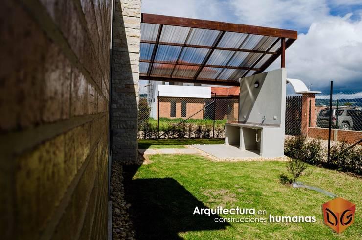 Jardines de estilo moderno de DG ARQUITECTURA COLOMBIA Moderno Cobre/Bronce/Latón