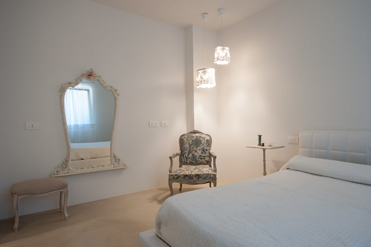 Dormitorios de estilo  por QUADRASTUDIO