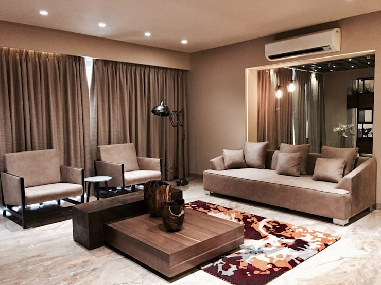 Iscon Platinum Show Apartment :  Living room by Studio R designs