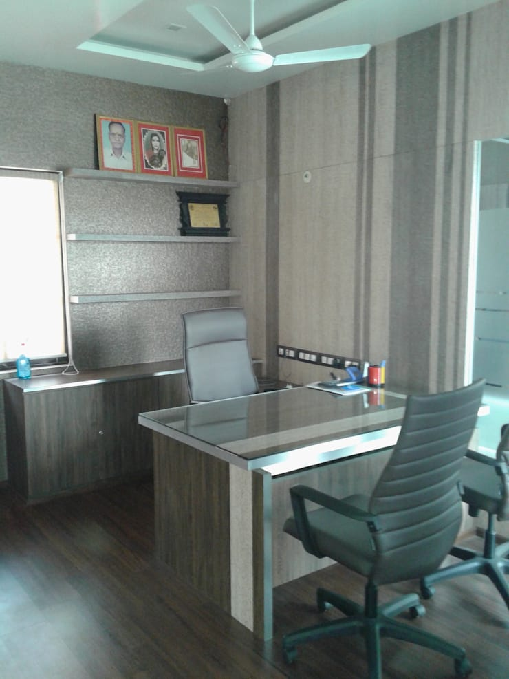 INTERIOR DESIGN OF OFFICE:  Office buildings by RED PAPER DESIGNERS PVT. LTD.,Modern