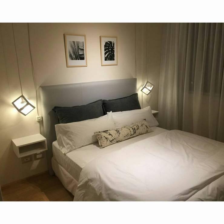 Iluminando departamentos para renta vía Airbnb!: Dormitorios de estilo  por Belmatel,