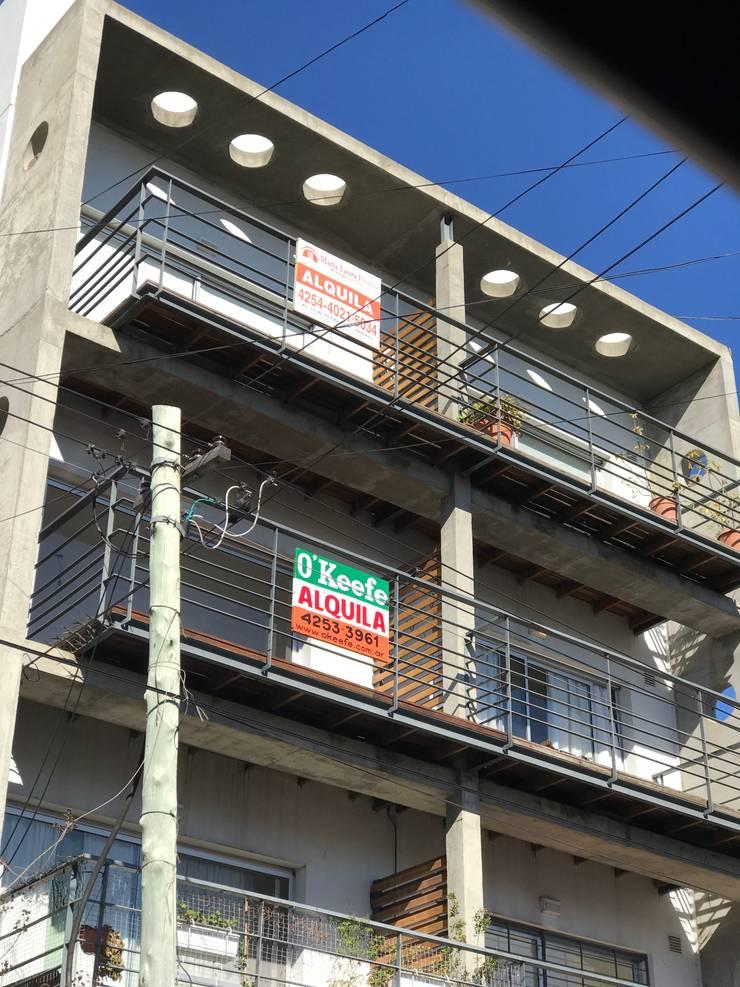 Vivienda multifamiliar : Casas de estilo  por EstudioSM arquitectura y Construccion