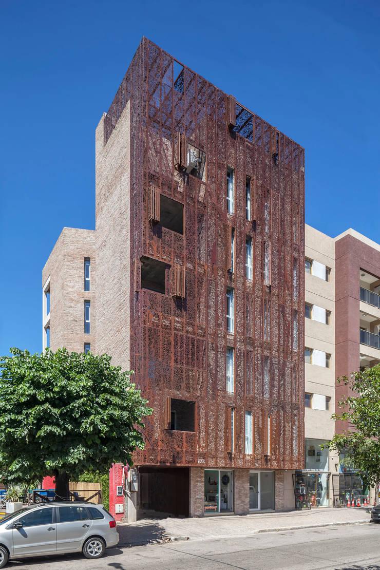 Rumah teras oleh Ciudad y Arquitectura, Modern