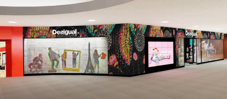 Exterior tienda Desigual: Espacios comerciales de estilo  por Priscila Meza Marrero