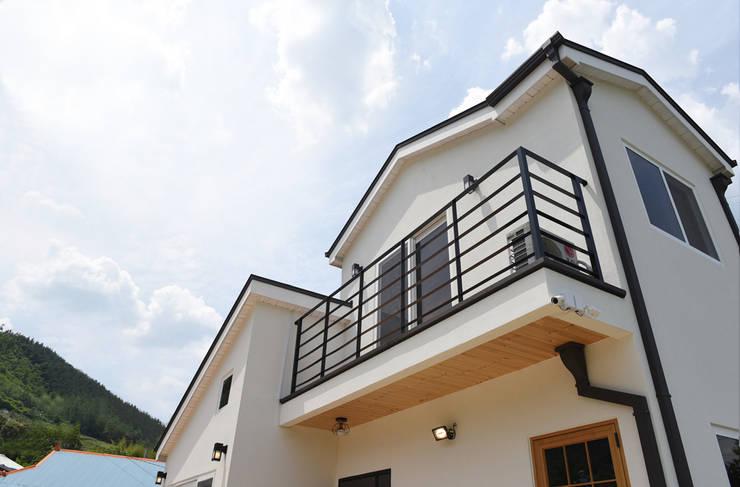 주택 2층: 한다움건설의  목조 주택