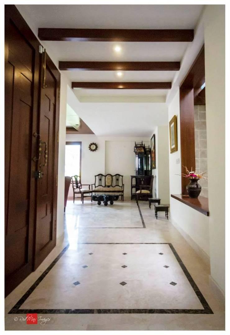 Rahaman's residence:  Corridor & hallway by Sandarbh Design Studio,Eclectic Plywood