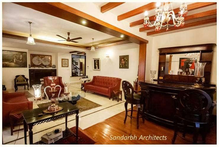 Rahaman's residence:  Living room by Sandarbh Design Studio