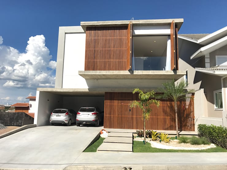 Casa EN2L: Casas  por Aoki Arquitetura