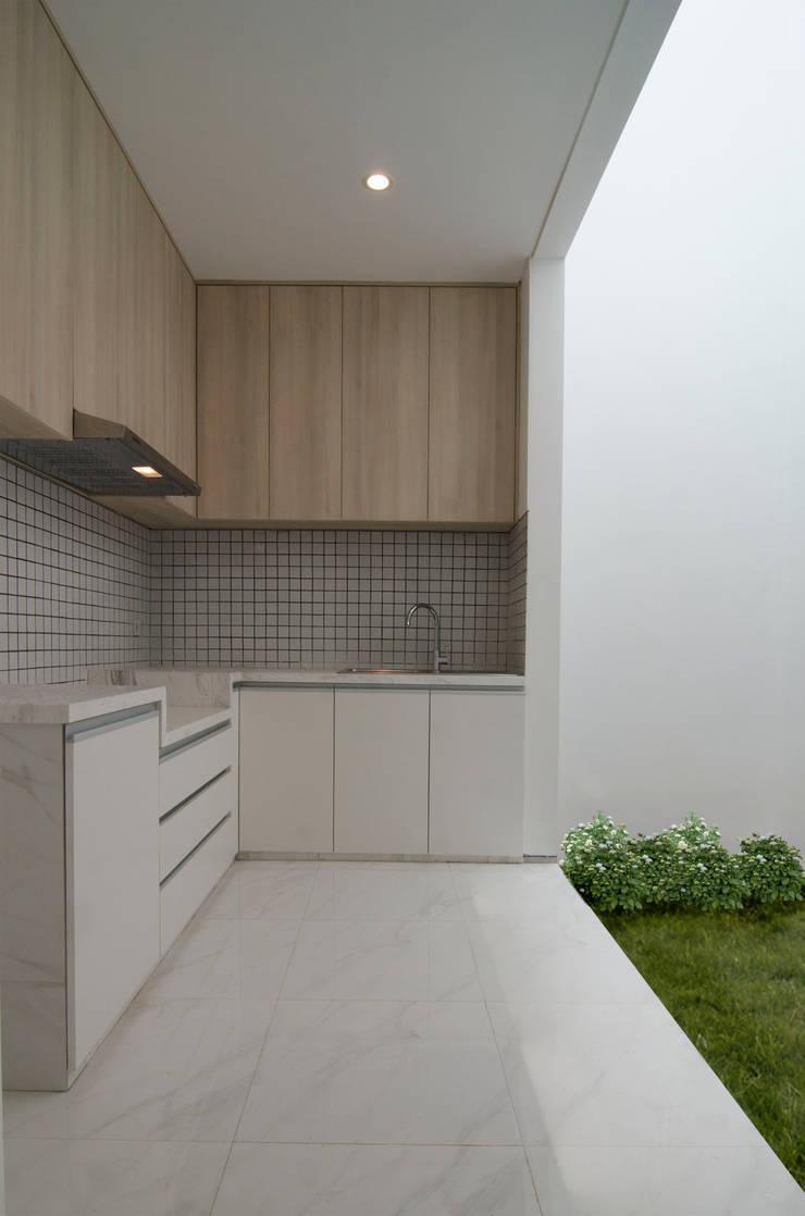 A House: modern Kitchen by KOMA living interior design