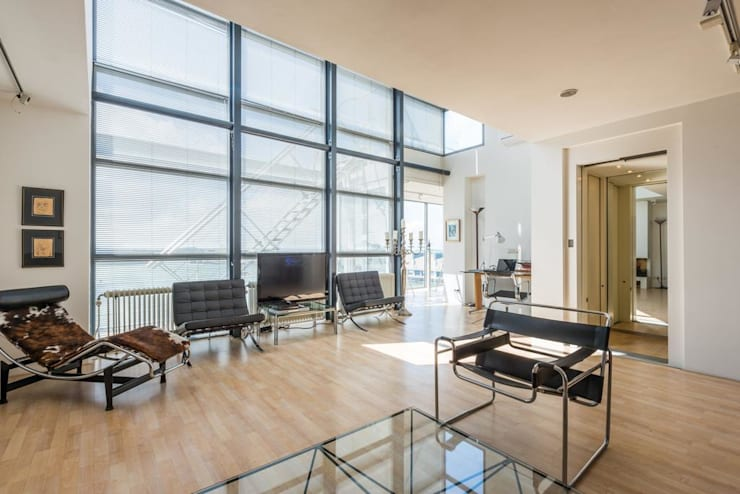 Penthouse Harbourview:  Woonkamer door Archipelontwerpers, Modern