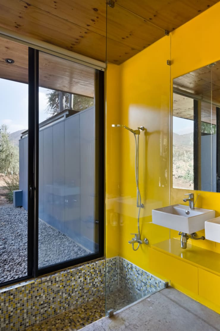 Casa Nogales : Baños de estilo  por Dx Arquitectos