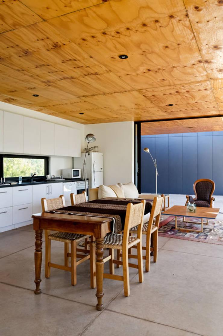 Casa Nogales : Livings de estilo  por Dx Arquitectos