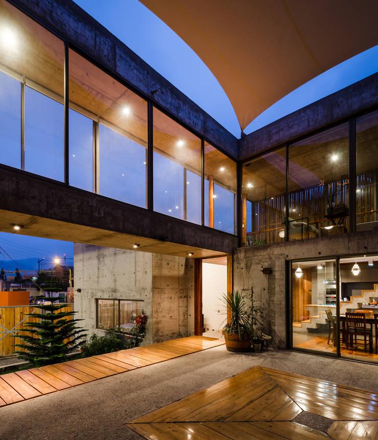 Casa Jardines del Sur : Casas unifamiliares de estilo  por Dx Arquitectos