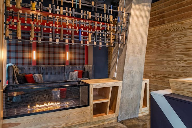 Planika Fire Place: modern Wine cellar by S. T. Unicom Pvt. Ltd.