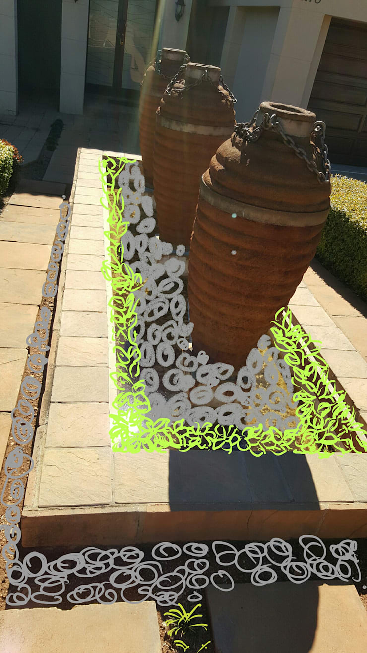Planning the revamp of a fountain:   by SOJE Interior, Design and Decor PTY (Ltd)