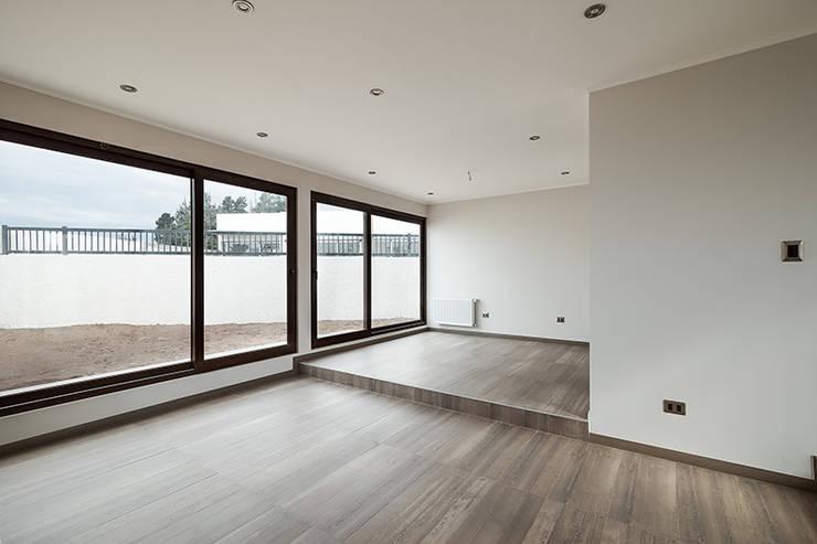 Casa Montemar 3: Livings de estilo  por Bauer Arquitectos