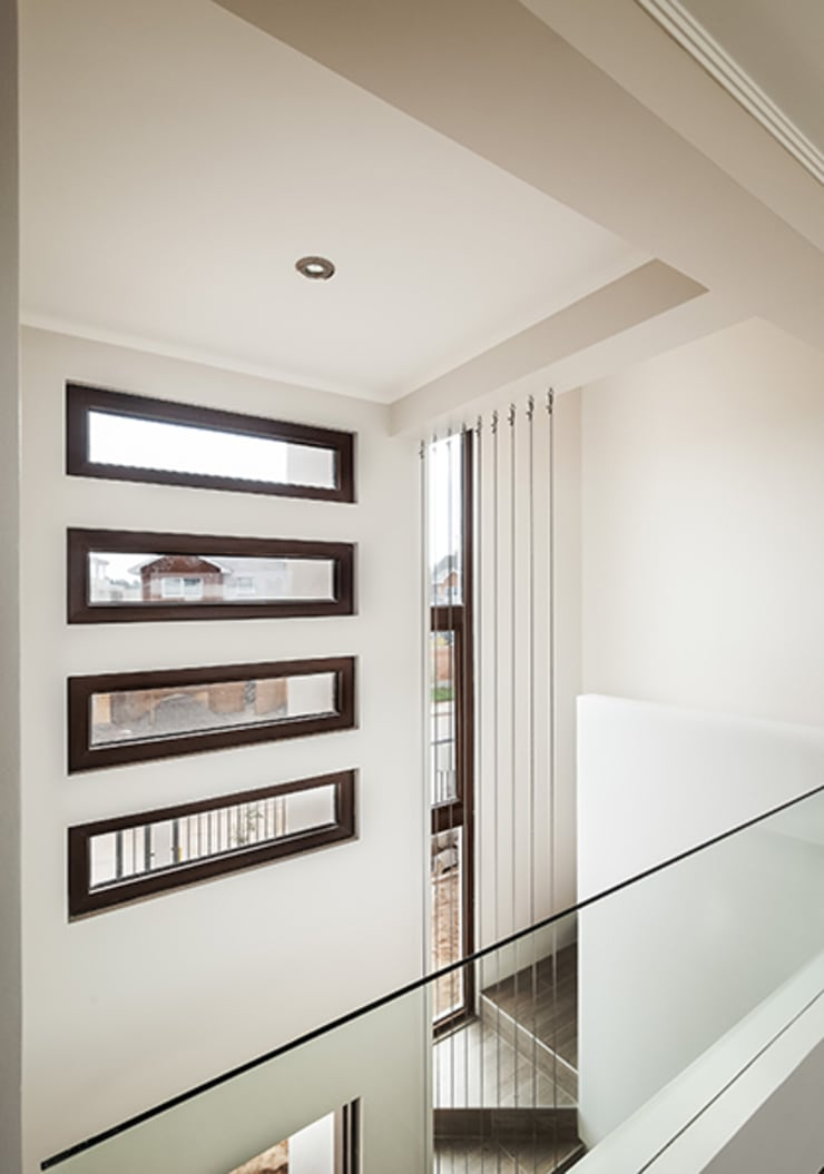 Casa Montemar 3: Pasillos y hall de entrada de estilo  por Bauer Arquitectos
