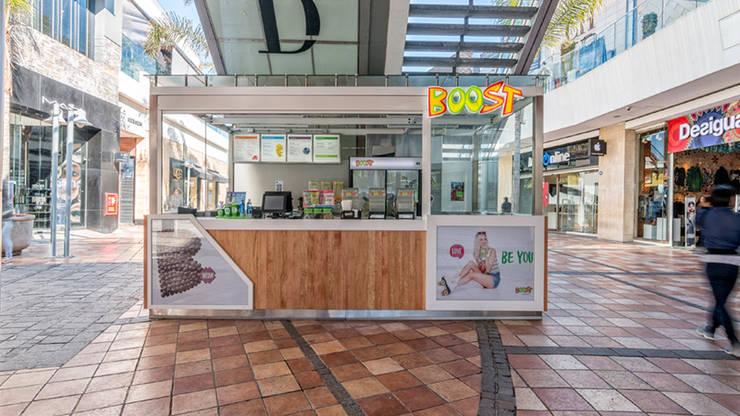Boost Parque Arauco: Espacios comerciales de estilo  por Bauer Arquitectos