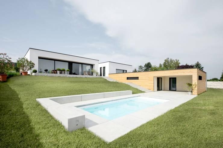 Projekty, eklektyczne Domy zaprojektowane przez wir leben haus