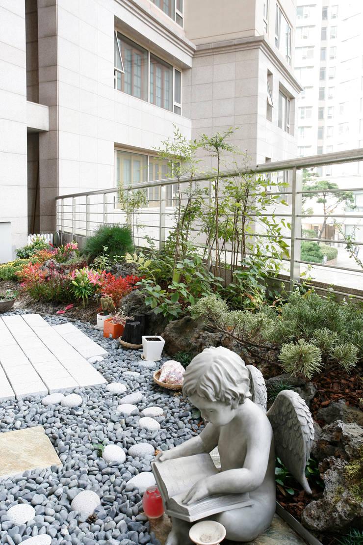 갤러리아팰리스 69PY: thedesigns의  정원