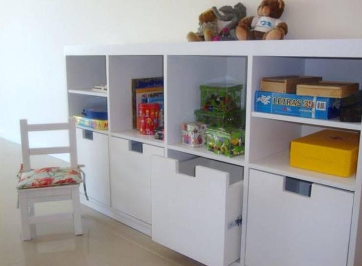 DISEÑO DE MUEBLES PARA UN CONSULTORIO INFANTIL: Estudio de estilo  por Arquitecta MORIELLO,