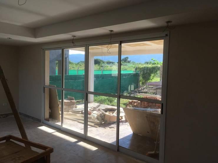 Casa en Alto Verde 2 – FE:  de estilo industrial por Abertuc,Industrial