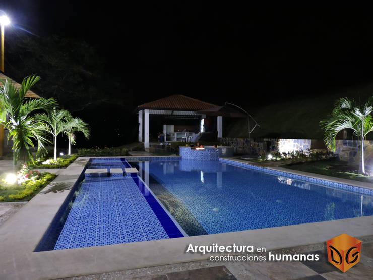 PISCINA: Piscinas de jardín de estilo  por DG ARQUITECTURA COLOMBIA