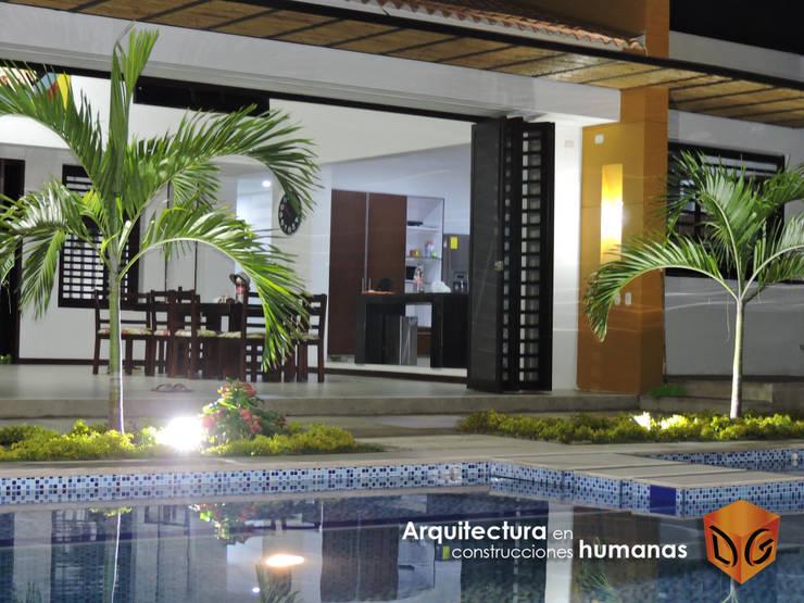 VISTA HACIA EL INTERIOR: Salas de estilo moderno por DG ARQUITECTURA COLOMBIA