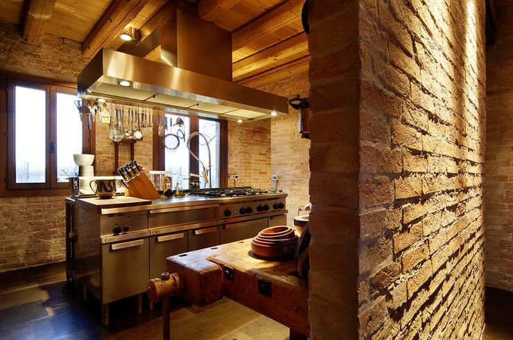 Cocinas integrales de estilo  por zanon architetti associati