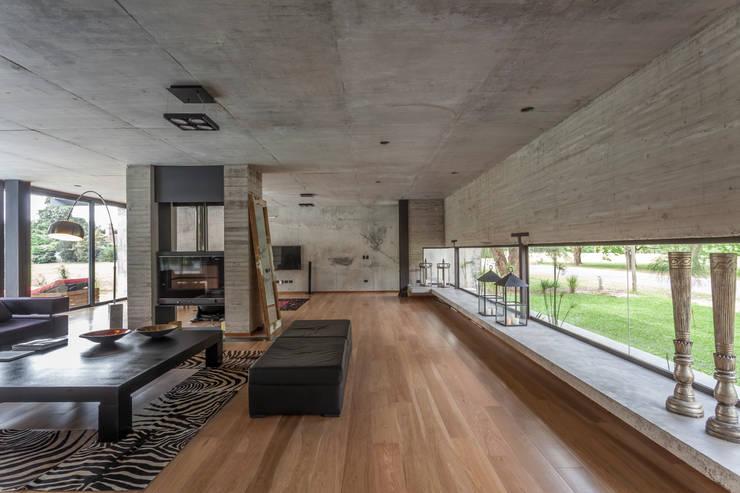 Casa HK: Livings de estilo  por Ciudad y Arquitectura,Minimalista
