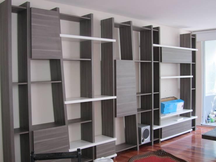 DISEÑO DE BIBLIOTECA MURAL: Livings de estilo  por Arquitecta MORIELLO,