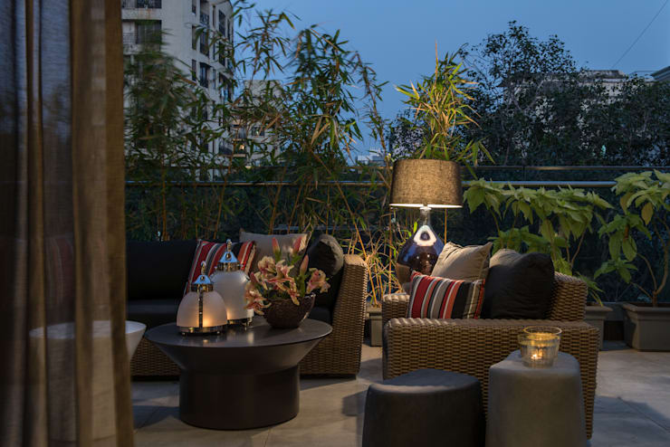 Apartment in Juhu:  Terrace by Rakeshh Jeswaani Interior Architects